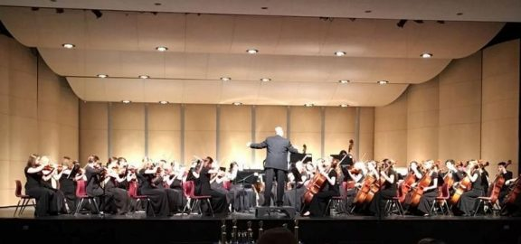 LMHS Orchestra on stage at Jefferson Invitational