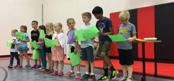 Novak Elementary Students receive perfect attendance awards in an assembly