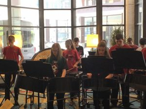 Members of the Excelsior Middle School Percussion Ensemble perform at the Iowa Bandmasters Conference in Des Moines