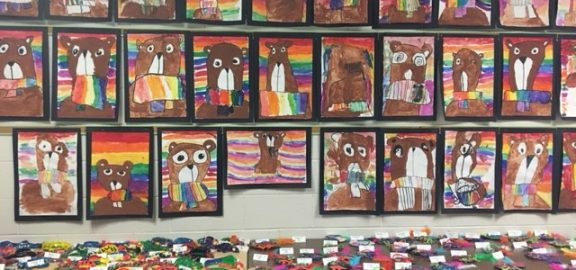 Numerous pieces of student artwork on display at Wilkins Elementary School