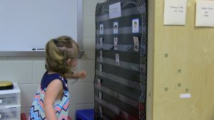 Student makes decision on how see is feeling by selecting appropriate card describing her feelings