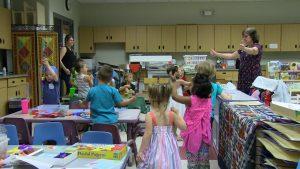 Students listen carefully to teacher's instructions